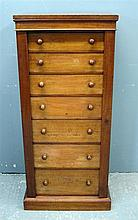 19th century mahogany wellington chest of seven drawers on plinth base