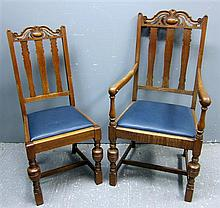 Set of fourteen early 20th Century oak rail back dining chairs with carved top rails, drop in seats and turned legs