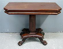 Regency mahogany foldover tea table, central pedestal on claw feet supports