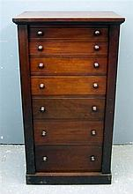 Early 20th century Mahogany wellington chest of seven graduated drawers on plinth base