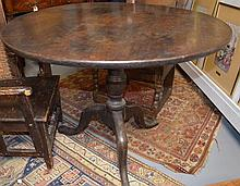 George III mahogany round tilt top table on tripod base