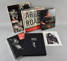 Four hard back books including Abbey Road: The Best Studio In The World by Alistair Lawrence (2012), Once There Was A Way by Harry Benson (2003), Rock Faces by Oliver Craske (2004) numbered 403/552 & signed to the inside, with 10x8 photography signed by the photographer Ian Dickinson, & Each One Believing by Paul McCartney (2004), (4)