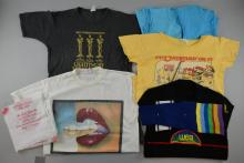 Five T-Shirts including Lee Electric, Bite The Bullet, We're Off To See The Wizzard x2, Roy Wood Put Mustard On It, WEA jumper, 5x Menu placemats for International Convention in London hosted by The Arden Family & Jet Records (11 items)