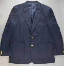 A navy blazer with four brass military / heraldic emblem buttons, believed worn at Star Wars Episode II UK Premiere, the James Bond exhibition & Lord of the Rings Cannes Film Festival Premiere 2001, together with a white unlabelled shirt & a pair of grey Sartorial trousers (3).Provenance: From the Estate of Sir Christopher Lee.