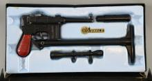 The Man From U.N.C.L.E., Lone Star Dies Cast Metal Gun set boxed, 7.63mm caps roll firing with butt extension piece, telescopic sight & silencer, box with original gilt and black U.N.C.L.E. paper labels