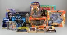 Dr Who Memorabilia including baseball cap from the 20th anniversary year 1983 (size small), 1983 20th anniversary bumper sticker featuring Peter Davison, 1980's style cyberman lampshade (new), Army of Ghosts figure set exclusive to Woolworths, Two paperback books signed by the special effects author, games, deskcards, illuminating chrome clock, 30th anniversary calendar signed by Peter Davison, jigsaws & other items