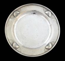 Georg Jensen Denmark, beaten silver dish , the border decorated with flower heads, 10 cms wide, English import marks, 48 grms