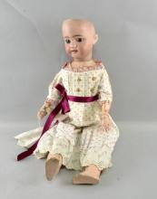 Simon and Halbig bisque headed doll with blue sleeping eyes, composition body and open mouth 52cm long,