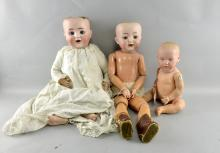 Three German bisque headed dolls two with sleeping eyes, all with composition bodies