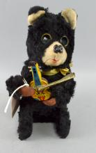 Japanese brown plush wind-up bear playing a violin circa 1950's,