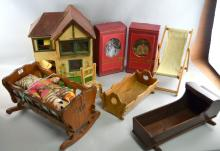 Painted wooden dolls house, a small quantity of furniture, a cradle, deck chair and sundry other items,