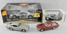 James Bond 007 Aston Martin DB5 in original packaging, Mercedes CLK 1:18 car, a 1935 Duesenberg SSJ car, boxed and an Aston Martin car unboxed,