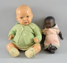 Early 20th century black bisque headed doll, marked 'HW' 26cm, and another,