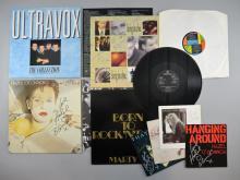 Twelve signed vinyl LPs and singles including ELO, Neil Diamond, Marty Wilde, Living In A Box, Stevie Nicks, Hazel O'Connor x3, Kiki Dee, Clark Datchler, Snap!, Ultravox (12)