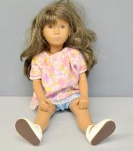 'Sasha' doll with tanned body and brunette wig,