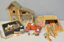 Tri-ang 1920's clockwork tractor, a collection of Britains and other makers lead farmyard animals and accessories, German painted wood block castle and a dolls house,