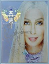 Cher, American Singer & Actress, poster for Living Proof Tour 2002, signed & inscribed 'Dearest Harry, I send you all my love', 39 x 29 cm, & another two colour photographs of Harry Goodwin meeting Cher, all framed (3). Provenance: Collection of Harry Goodwin 1924-2013, resident photographer of the BBC's Top of the pops from its first programme in 1964 until 1973. Bequeathed by Harry Goodwin to The Christie charity Manchester and entered into sale by them.