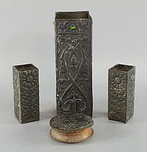 Three pewter overlay vases with jewelled detail.