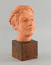 Terracotta study of a male head in Classical manner, on carved wooden base, signed 'Ellis', 25cm high