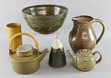Group of studio pottery. Including a John Jeffs teapot, a Robin Welch cylindrical vase, Aylesford jug and bowl and a conical form preserve pot.(5)