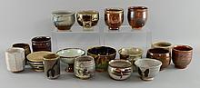 Group of studio pottery Yumoni and small bowls various makers