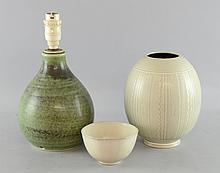 A 1950's Danish Bornholm pottery onion shaped table lamp base.  Designed by Michael Andersen, decorated in a mottled celadon glaze, impressed three herring back stamp, Bornholm, Denmark, 5922, 27cms high, together with an Aluminia vase 18cms high and