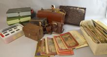Various cameras and accessories including Bolex movie camera, photographic sides and a collection of maps