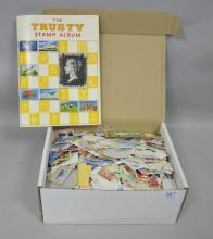 Collection of various loose stamps and an empty 'Trusty' stamp album,