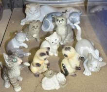 Selection of Royal Doulton, Goebel, Nao and Lladro figures of cats,