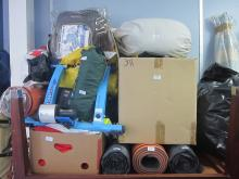 Collection of outdoor equipment and clothing to include rucksacks, camping mats, diving wet suit etc. NOTE: VAT IS ADDITIONALLY PAYABLE ON HAMMER PRICE ON THIS LOT