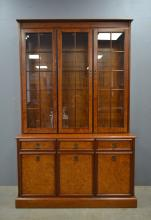 Reproduction mahogany and glazed cabinet with drawers and cupboards below, in two sections.