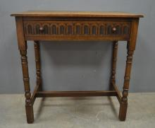 Oak desk with single frieze drawer together with a mahogany drop leaf table