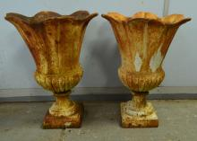 Pair of cast metal urn shaped planters together with two Victorian cast iron fireplaces