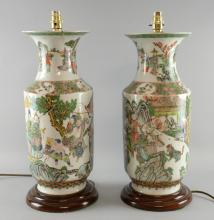 Pair of Chinese famille verte vases decorated with figures in a landscape, on hardwood bases, 47cm high (converted to lamps)