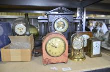 Black slate mantel clock, brass carriage clock and five other clocks.