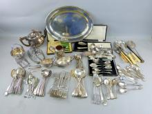 Selection of silver plated wares to include an oval tray, teapot, toast rack, flatware and other items,