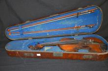 Early 20th century violin with two bows in earlier wooden case, another wooden case with two part violins and two bows