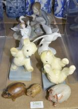 Lladro porcelain figure, two Royal Doulton figures, Sweet Dreams and Images of Nature together with German porcelain bear bookends and three novelty small pigs.