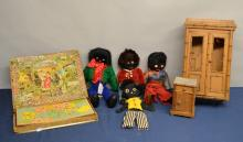 Four felt Golly dolls, early 20th century dolls wardrobe and matching bedside cupboard, and a jigsaw Atlas Geographique