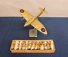 British RAF pilots wooden model of spitfire Mark VB on a wooden base with hand written paper label 17cm high, carved 1942 whilst being billeted with the current vendors Grandmother, with a set of painted clay Indian army figures,