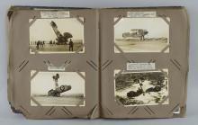 Album of postcards depicting warships, sailors, and aircraft,