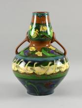 Wileman Foley intarsio twin handled vase, designed by Frederick Rhead, painted with flowers and with central freeze of geese, height 30cm.