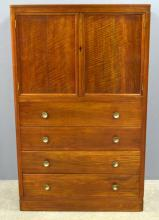 W.H Russell for Gordon Russell Ltd, American walnut and ebony cabinet , with two cupboard doors over four drawers to plinth base, design no.992/7162. Height 147cm, Width 92cm, depth 51cm, Label to underside of top drawer, Circa 1931