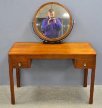 W.H Russell for Gordon Russell Ltd. 'Shipton dressing table'. ,Circa 1930, American Walnut & Ebony dressing table with circular swing mirror, design no. 989. 128cm x 107cm x 51cm