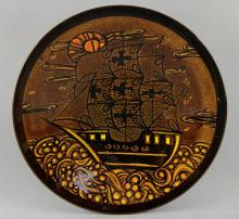 A Poole pottery Aegean charger, decorated with a sailing ship, by Diana Foreman.  41 cm diameter