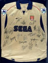 Arsenal Football Club - The Invincibles Squad 2003/04, fully signed Thierry Henry match worn away shirt, mounted & framed, 37 x 29 inches.Provenance: With certificate of authenticity from Arsenal. Worn by Thierry Henry on the 26th October 2003, signed afterwards.The vendor has had senior roles at top telecommunication leaders for over 20 years and was Vice President of Samsung UK & Ireland for a number of years. During his working career he had access to many individuals in the music, movie & sporting industry through events, functions and friendships he made during his time in the industry.