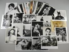 150 approx 10 x 8 inch stills including Lauren Bacall, Humphrey Bogart, James Dean, Errol Flynn, Greta Garbo, Alfred Hitchcock, Grace Kelly, Marilyn Monroe, Shirley Temple & others (150 approx)
