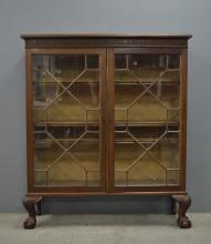 Mahogany glazed bookcase on cabriole leg