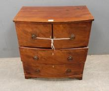 Small mahogany bowfront chest with cupbo