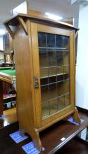 Oak and glazed front cabinet with open s